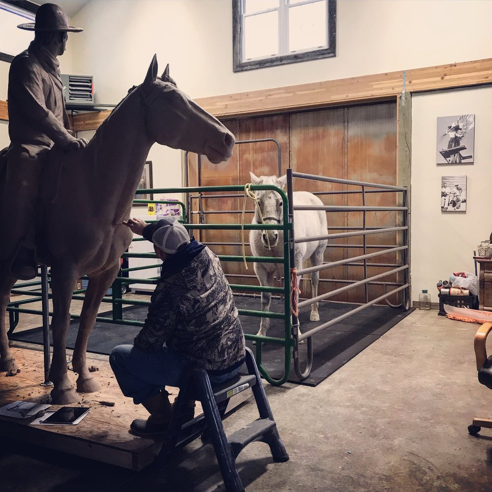 """Dustin working on his """"Father of the Trail""""/""""Oliver Loving"""" monument this winter in his Wyoming Studio with a live """"model""""."""