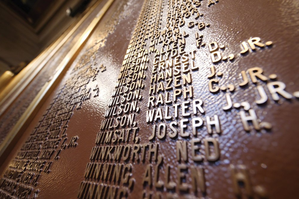 Bronze plaques in the historic Alger foyer pay tribute to veterans from Grosse Pointe