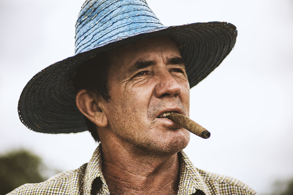 Cigar Man - This man worked in an eco-farm in Vinales. He was taking a break from his chores to smoke a cigar and I sneaked a shot of him.