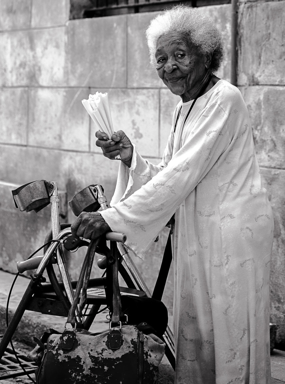 Peanut Seller - This picture reminds me of India. Similar to India, it is common to find street vendors selling all sorts of snacky type food in Cuba. Those paper cones contained salted and roasted peanuts. Boy... were they delicious!