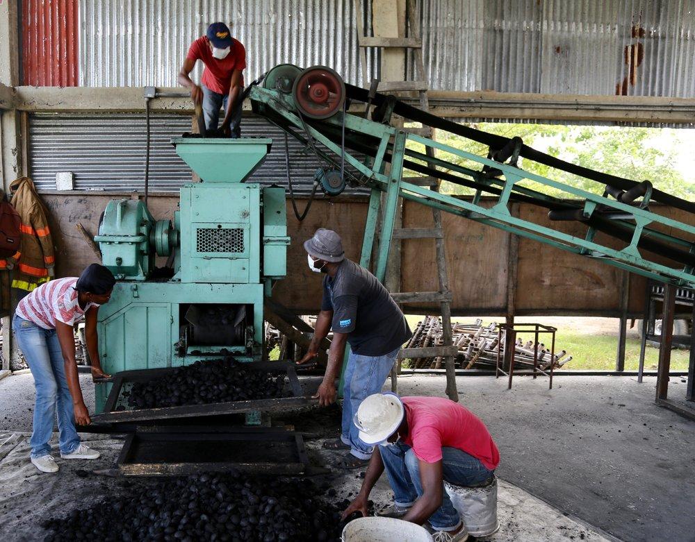 Men processing charcoal.jpg