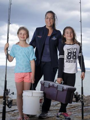 Gretta fishing with her two daughters
