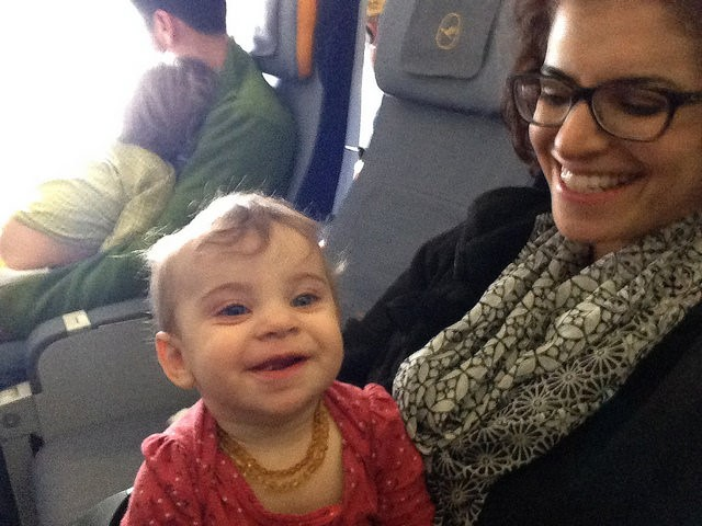 Flying with two young children, meant they often ended up on our laps even if they had their own seats.
