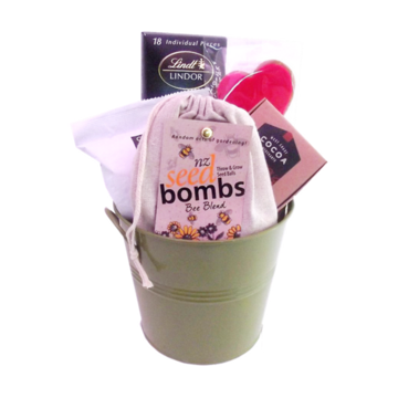 "A great gift to make anyone smile - sweet treats and a fun bag of ""throw and grow"" (very cool!!) seed bombs.  No gardening experience required - just lob them out there and watch the wildflowers grow as mother nature breaks them down and does her thing.  Seed bombs come in bee, butterfly, ladybug and healing herb mixes.   $48.50"
