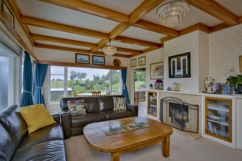 There is a large living room, with plenty of space, and higher ceilings. There is a compliant log burner.