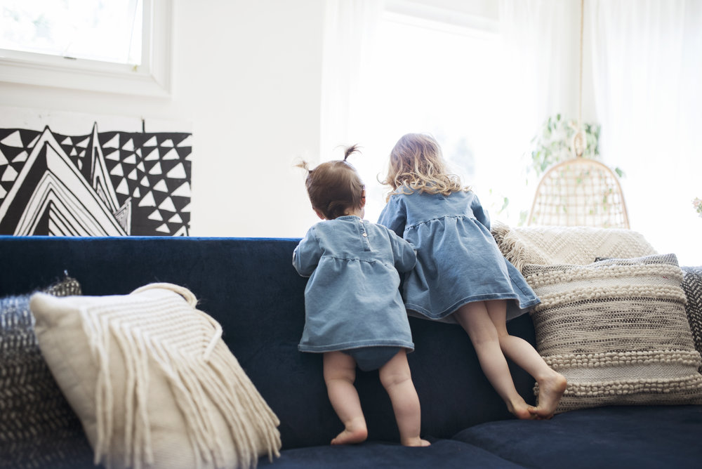 Seattle lifestyle photographer girls standing on blue couch
