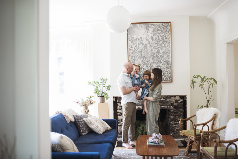 Seattle lifestyle photographer family stands by fireplace