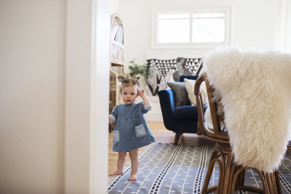 Seattle family photographer girl playing in living room