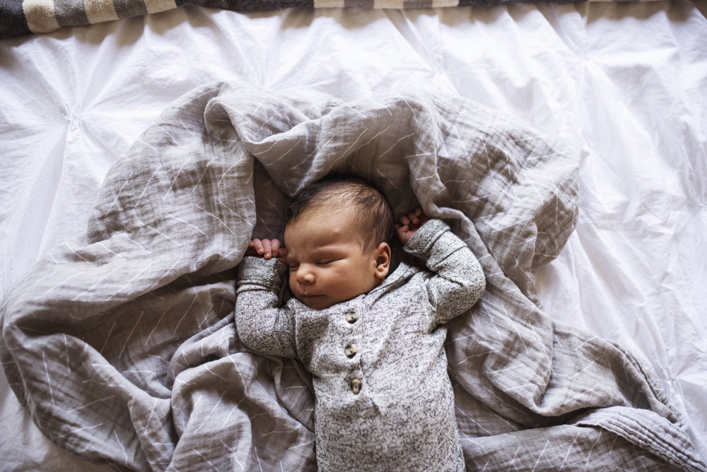 Newborn Lifestyle Photographer baby sleeping on bed