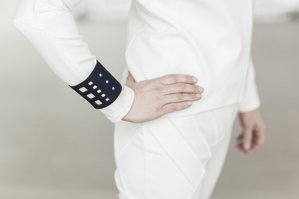 Pictured here is a wristband with blue lights integrated to represent the concept of housing electronics of various sorts into cushioned neoprene (a camera, heart monitor...etc.)