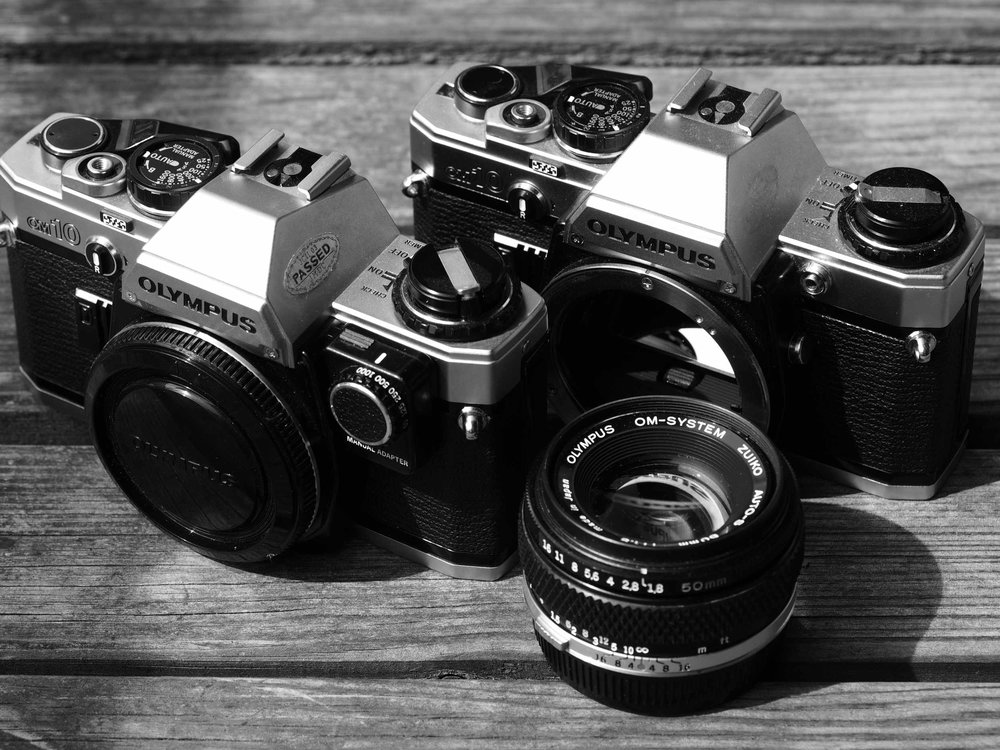 My two Olympus OM10 Bodies - one with the Olympus OM10 Manual Adapter - and one Olympus Zuiko Auto-S 50mm 1:1.8