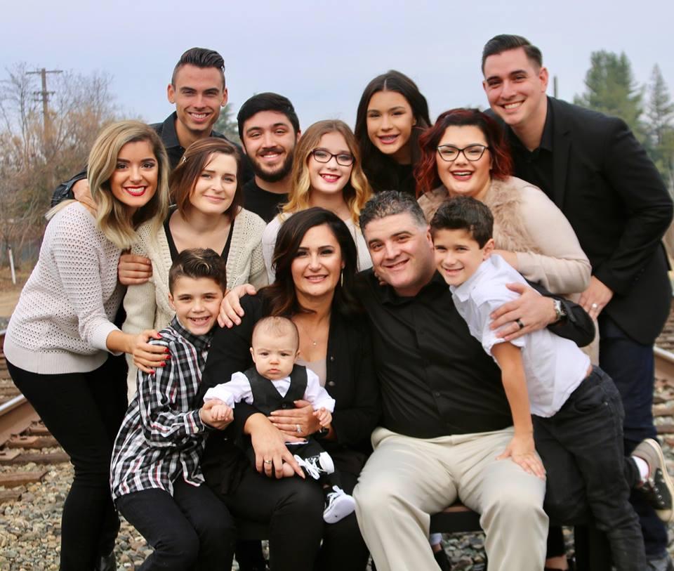 Back row: Adam (23), Lance (24), Michaela (15), Jordan (27); Middle row: Ciera (22), Christine (23), Madeline (14), Bailee (25); Front Row: David (11), Analyn, Baby Harold (1), Brandon, Daniel (8)