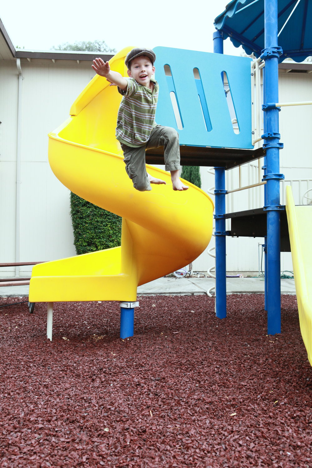 Child jumping from play structure at Teen Challenge NorWestCal Nevada property. Children can enjoy healthy relationships with their parents and have positive conversations about drugs and alcohol, even at young ages.