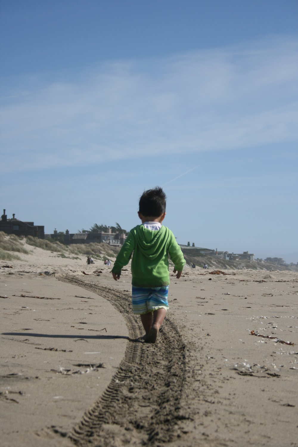 Child walking in freedom along the beach in Northern California. Part of a trip with Teen Challenge NorWestCal Nevada.