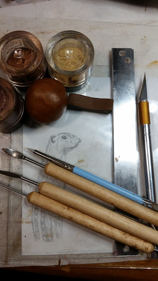 - You will need at least one flat glass plate (I use two), conditioned polymer clay, a sketch or photo, craft knife, sculpting tools,a tissue blade, chalk pastel, and corresponding shades of mica powders.  If you're adding this to pre-baked clay, you'll also need liquid clay for adhesive.
