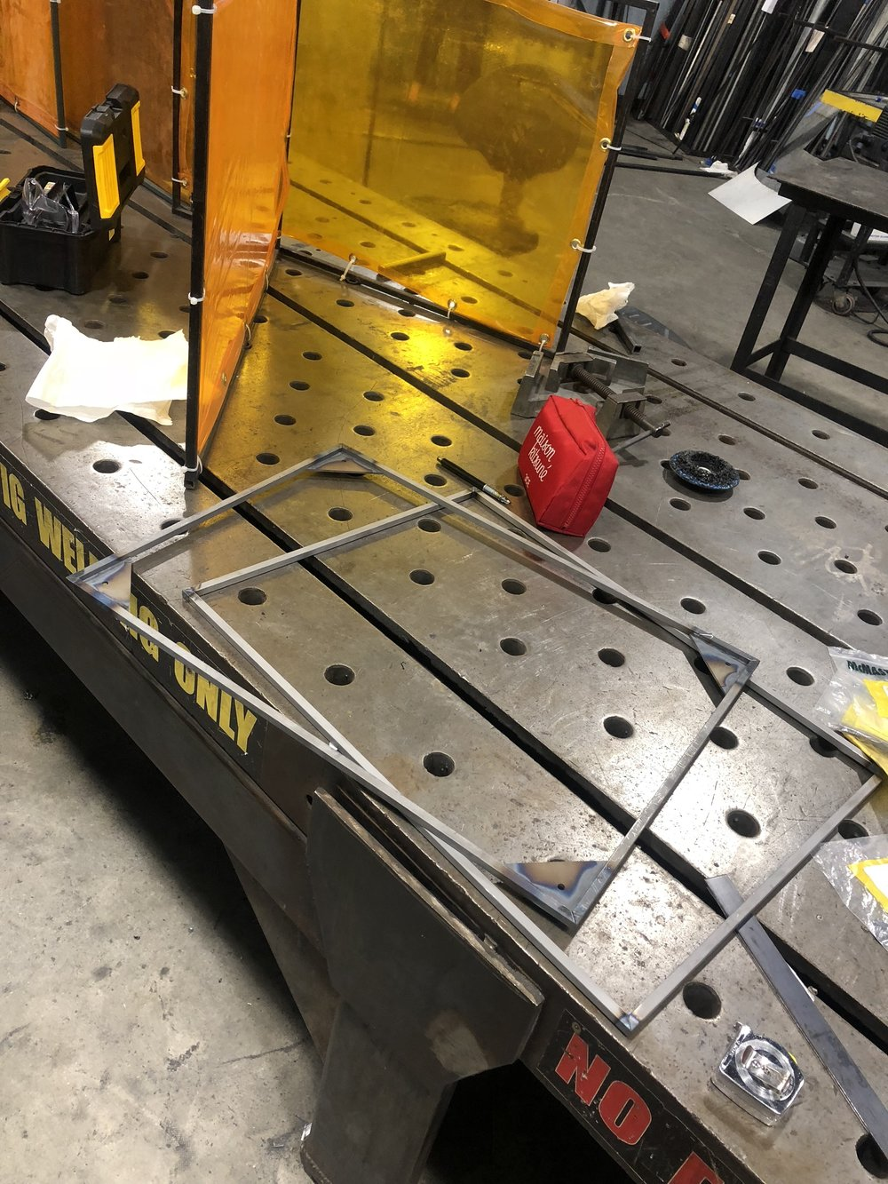 1. 3/8 Square tubing was cut and MIG welded together to create the seat base structure.