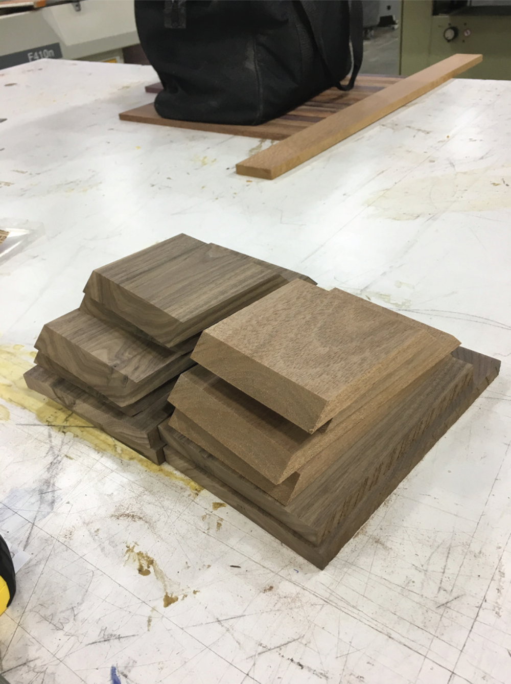 1. Firstly, the rough walnut wood was jointed and planed, then cut into rough dimensions. Then the sides were cut at a 45 degree angle to allow glue up .