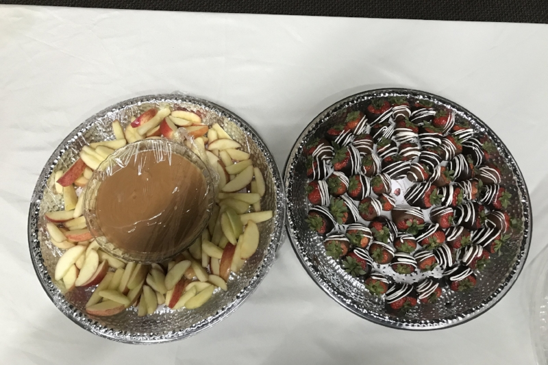 Home caramel platter with sliced apples (left) and strawberry dipped variety platter (right)