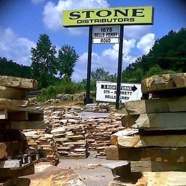 Keep an eye out for our sign! Our stone yard is easily visible from the I-75 bridge.
