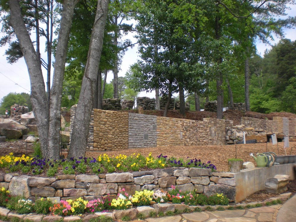 Stone Flowerbed and our Sample Wall