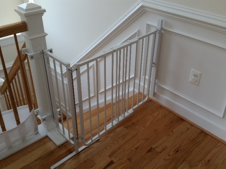 """A """"Wall"""" to Mount a Gate - What happens when there is no wall along the bottom few steps or when the top stair lands beyond the newel post?"""