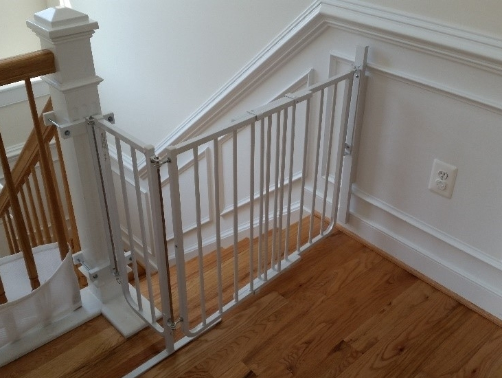 "A ""Wall"" to Mount a Gate - What happens when there is no wall along the bottom few steps or when the top stair lands beyond the newel post?"