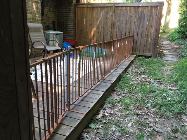 *Note: The first section (door) of the gate is slightly angled because we mounted the gate to the existing deck post, which stood a little wider than where the gate and T-bars line up.