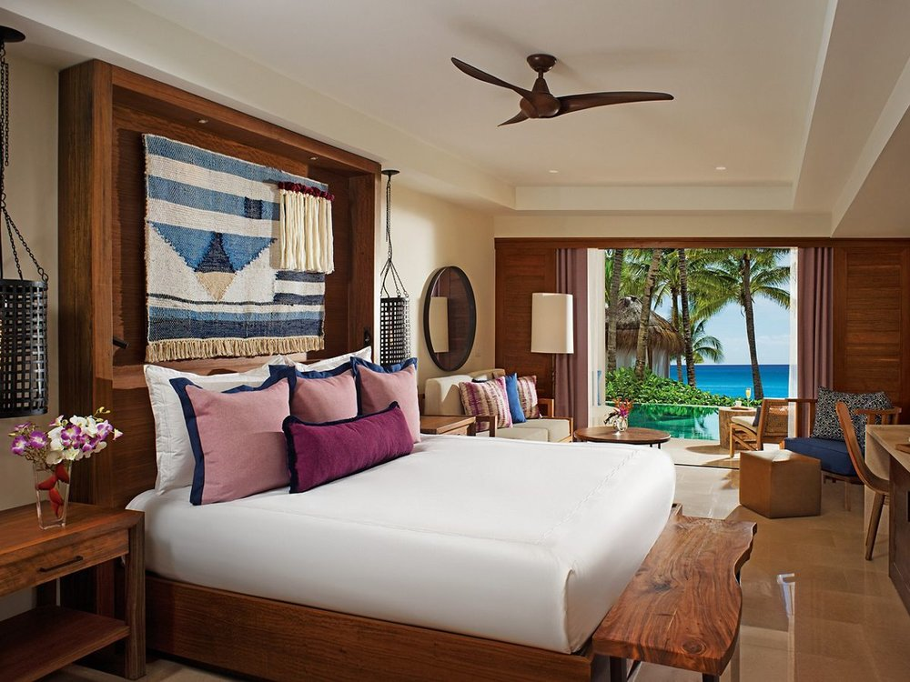 Jr. Suite Swim Out - One king-size bed or two queen bedsFull bathroom with two rain showers and water closetFurnished terrace with direct swim out access to poolCaribbean style décorTropical view