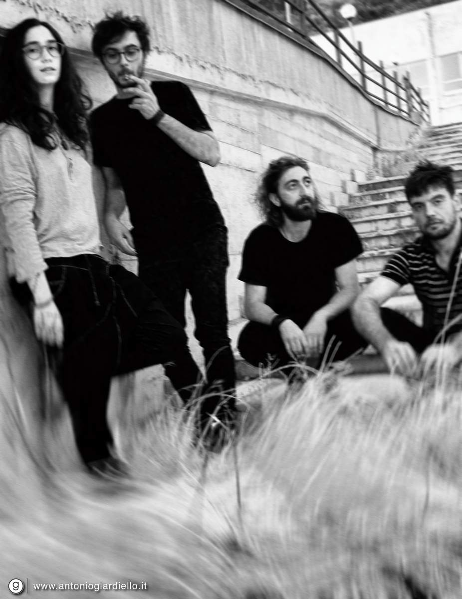 ↑ Fig.1 Slow Nerve 2017 «  EN - Bio:  Slow Nerve  was born in June 2016 in the province of Benevento. Four guys with different human needs, finding music as the only common thread. By starting to share this passion, a group was born. From this experience a set of borderline nights and a dozen songs, that express various musical experiences and influences, came out. The sound of the band is defined but eclectic and ranges from psychedelic and post-rock ambients for more distorted and marked sounds without leaving out smooth melodies. In May 2017, they met the Karma Conspiracy Records, which will release their first studio work in October».