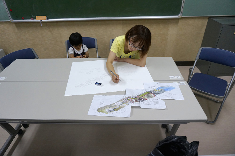 Minami Sanriku resident, Goto-san commenting on her transect drawing.