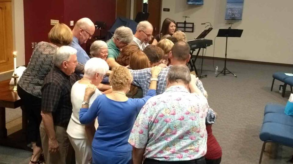 Church members praying over our recently confirmed young people.