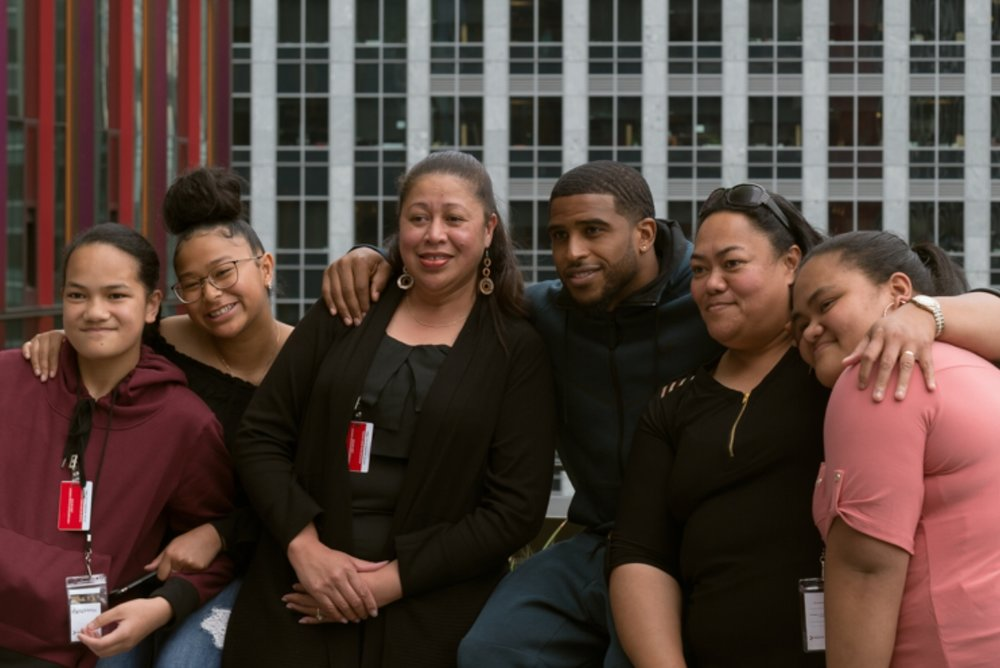 Seattle Seahawk linebacker   and Greater judge  Bobby Wagner  poses with a family of graduates at one of our events at Amazon HQ.