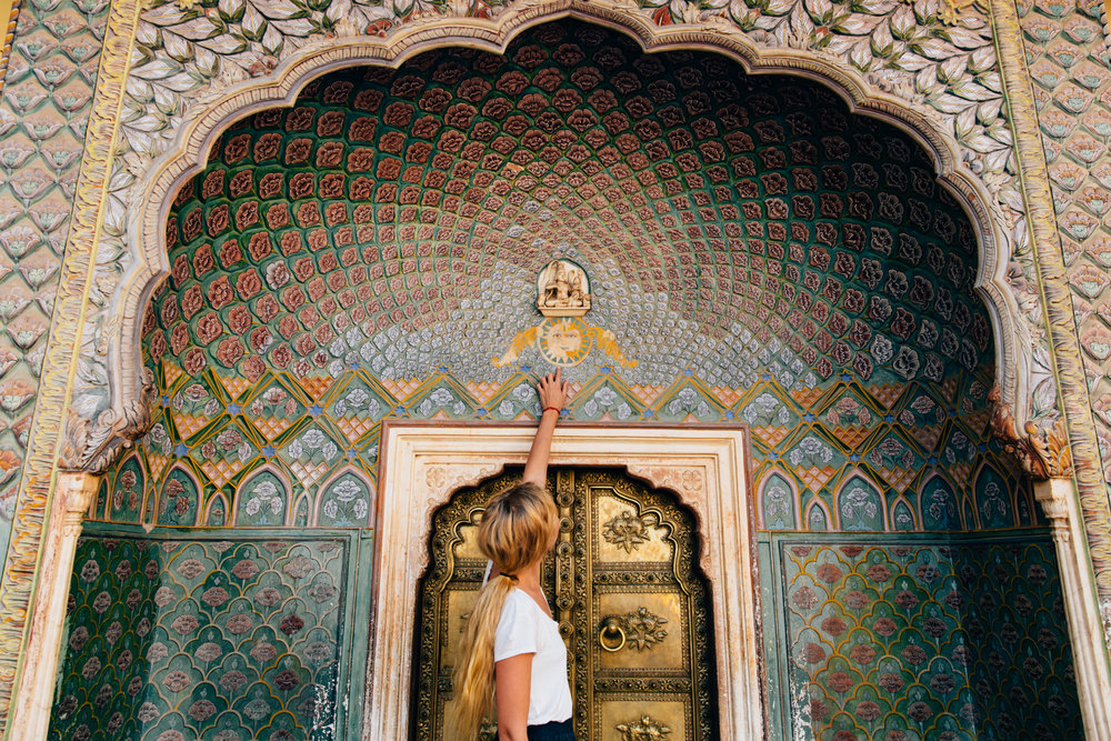 A photo of Emily under an archway in Jaipur's City Palace