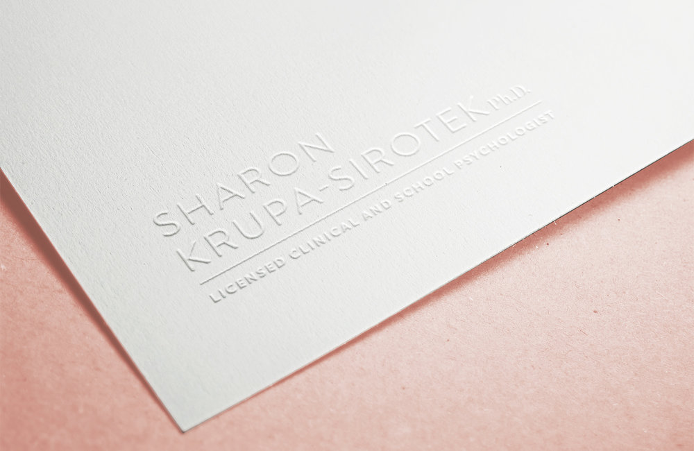 The Sharon Krupa-Sirotek logo embossed on nice paper
