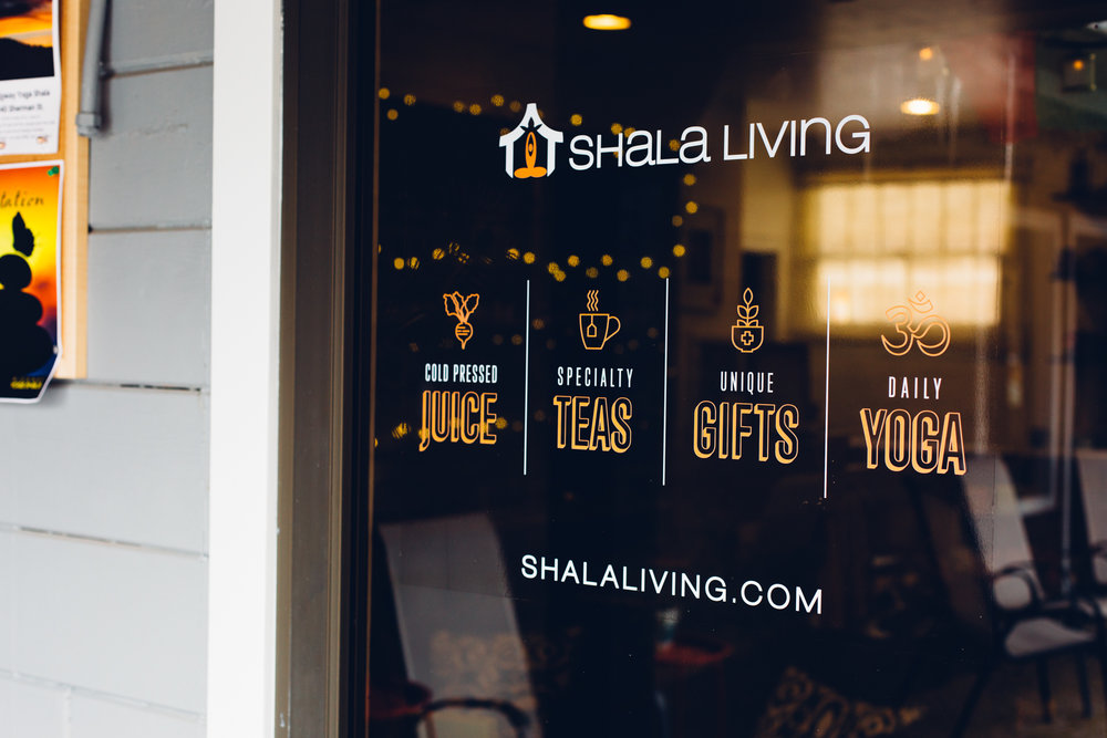 Photograph of the door signage we designed and applied for the Ridgway Yoga Shala