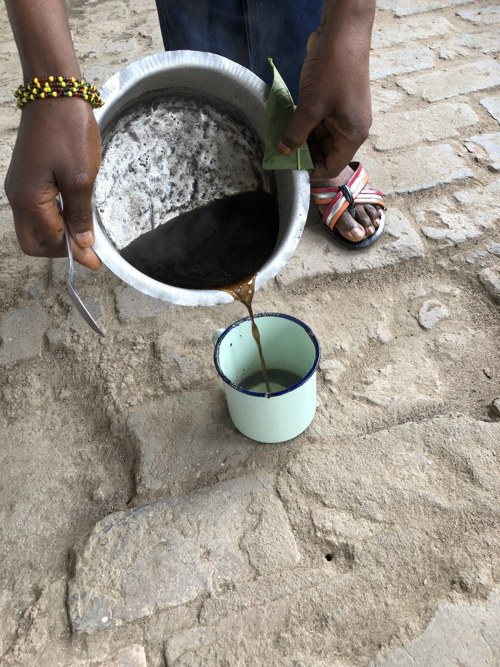 Morning coffee made with local beans. Often, people flavor the boiled water with a local herb that tastes like lemon grass, which gives a cool new dimension to the taste.