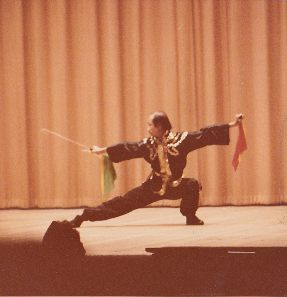 Grandmaster Chan Pui performs double tiger hooks at the John Hancock Hall in 1976.  Boston, MA.