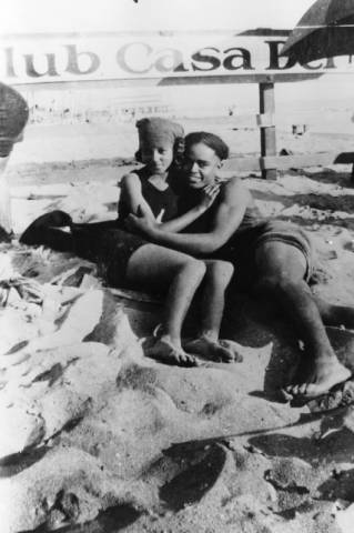 Verna Dekard and Arthur Lewis at the segregated section of the Santa Monica beach known as Ink Well, shortly before they married. They are in front of a fence with a sign for Club Casa, a private beach club in 1924.