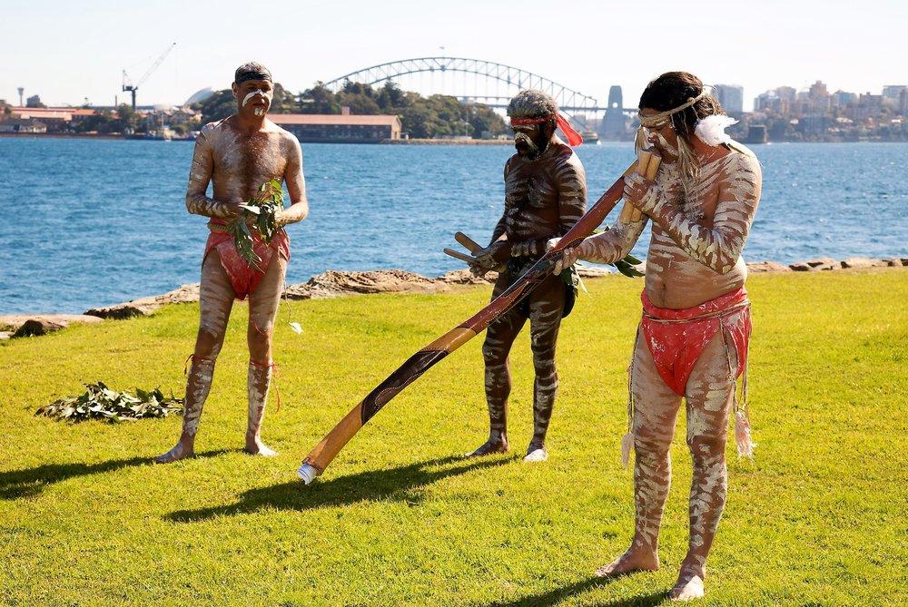 Indigenous Australians playing Didgeridoo