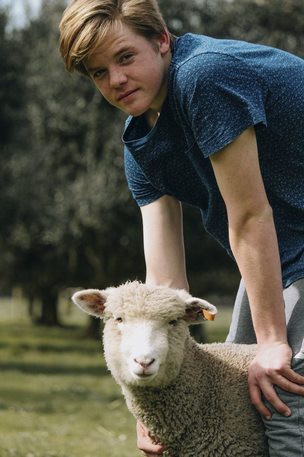 Tom with a lamb.