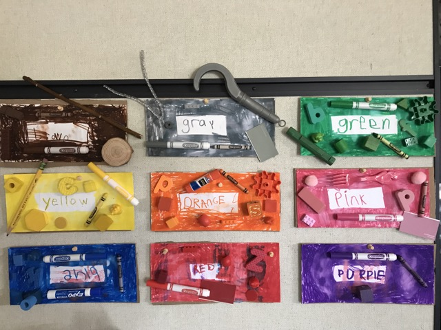 Our color cards made with found objects. Photo taken before I realized 'blue' was upside down. Who saw it and told me? A student!