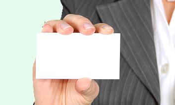 Image description: Hand holding blank business card.