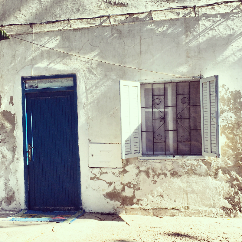 blue door and white walls