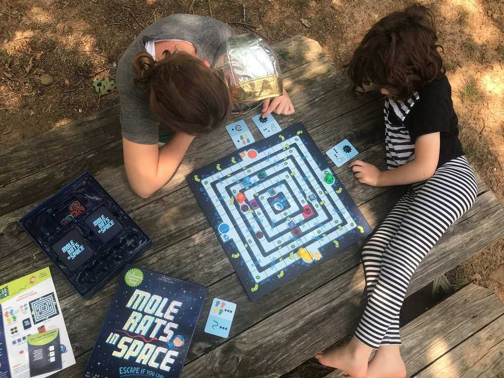 Institute a family game night at your house. Playing games together with the family has numerous benefits, both academic and social.   #familygames #screentime #reading #parenting #dadsuggests