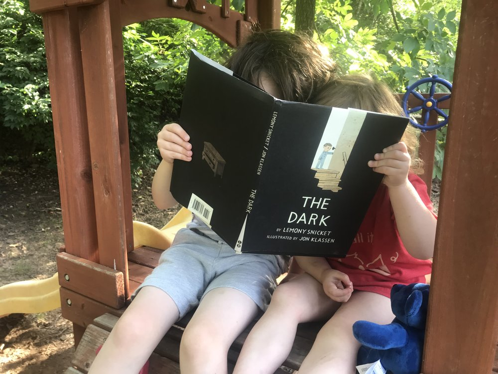 Read together with your kids. Reading aloud every night has an incredible amount of benefits for your child.   #familygames #screentime #reading #parenting #dadsuggests