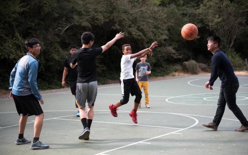 Playing basketball with kids