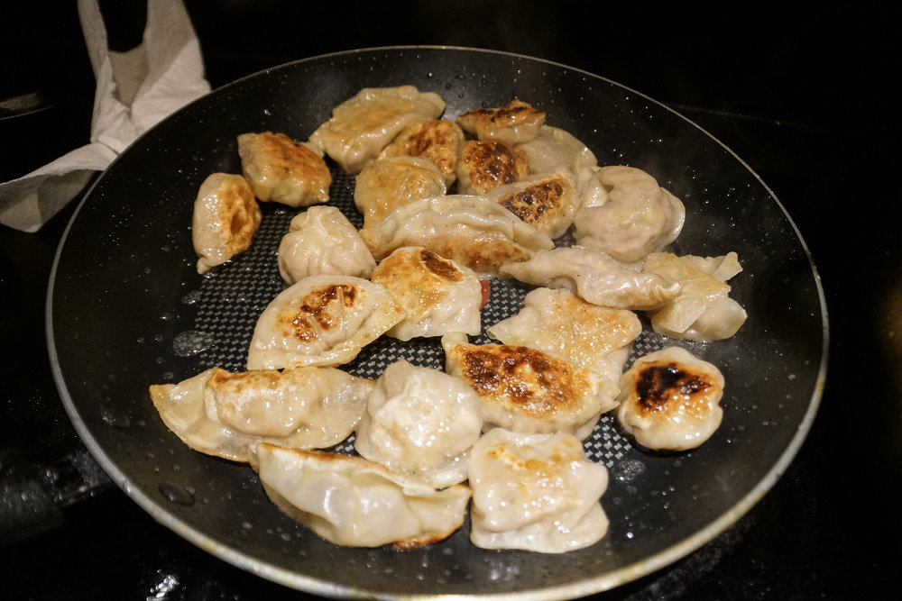"Nothing says ""Happy Chinese New Year"" quite like potstickers on some nonstick frying pans!"