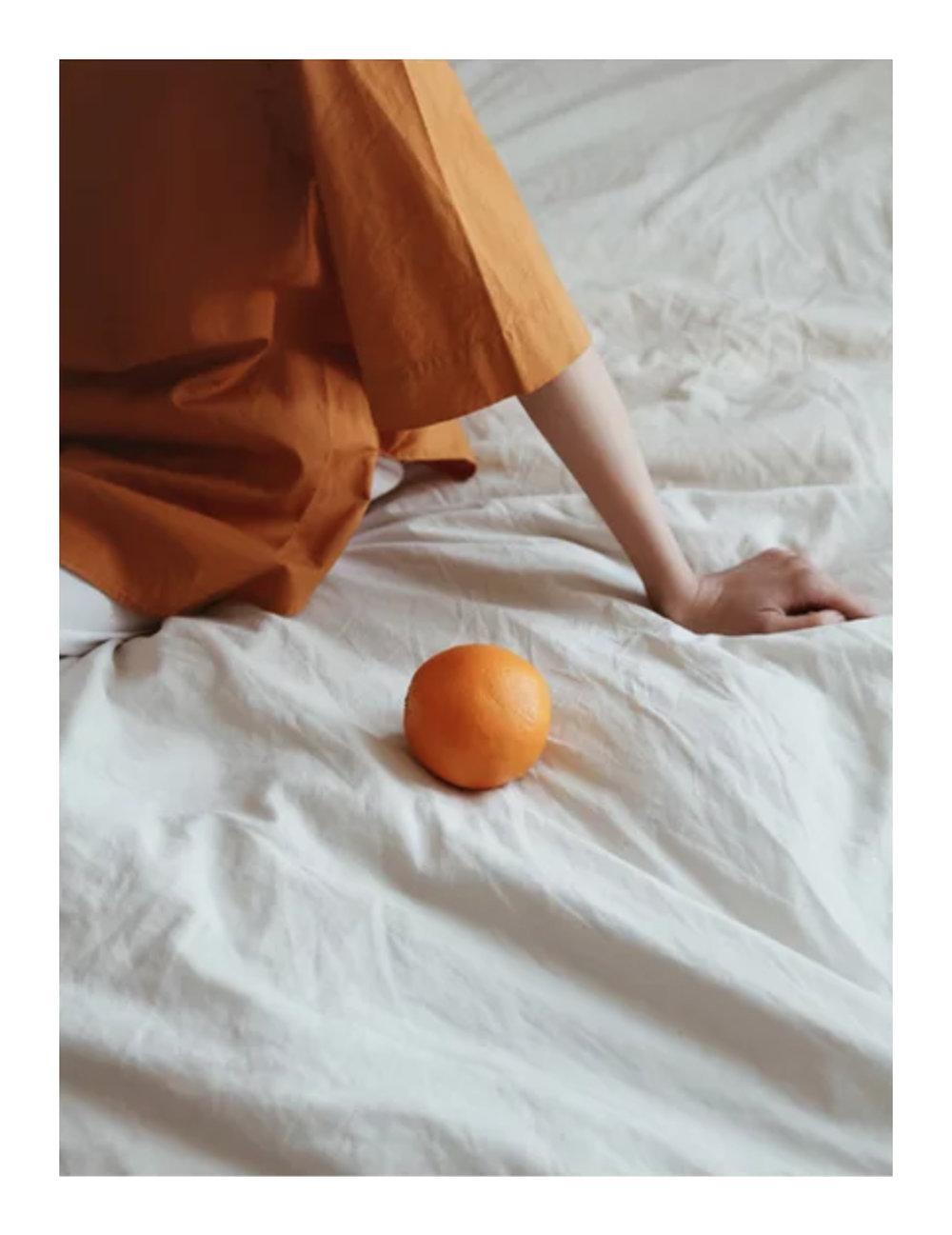 Orange, $42  —She's Got Wonder, Society6