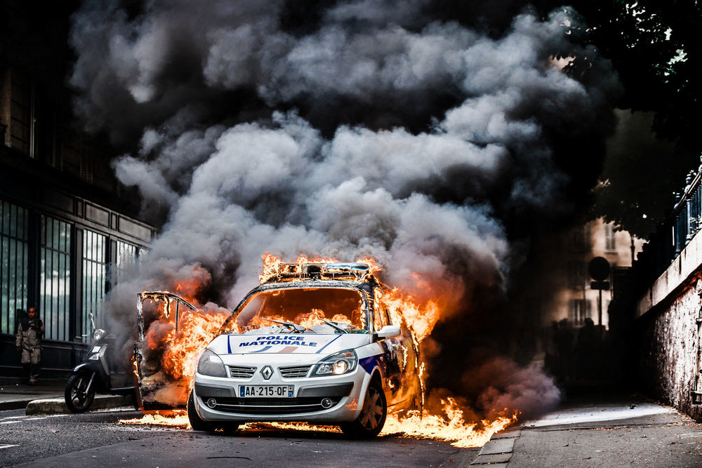 POLICE CAR BURNING DURING A PROTEST