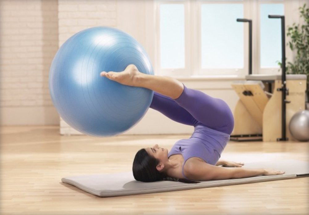 Pilates Mat with Ball Girl.PNG